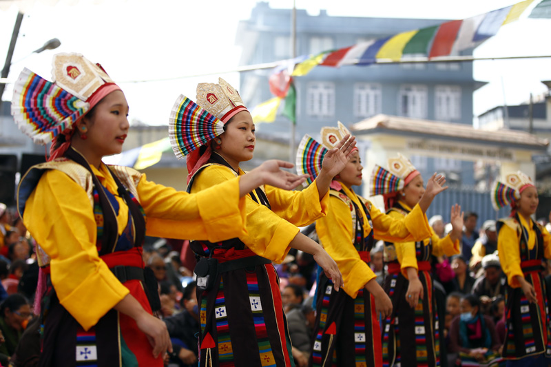 Tibetan women perform a traditional dance during a function to mark Lhosar or Tibetan New Year, at Bhirkuti School in Bouddha, Kathmandu on Thursday, February 11, 2016. Photo: Skanda Gautam